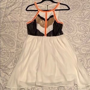 White dress with black and gold glitter